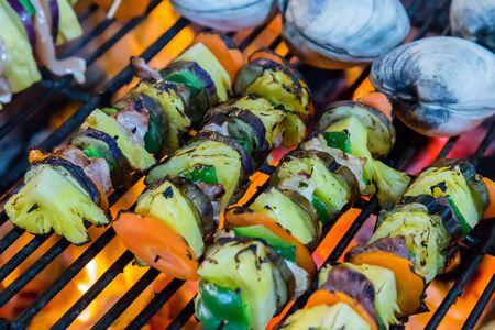 kebob: Fried skewers Grilled Vegetables on the BBQ. Background eat Barbecue Grill Vegetable.