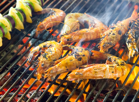 charcoal: prepared shrimp grilled barbecued mixed seafood in BBQ Flames.