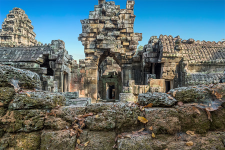 woodland sculpture: Ruins wall of Angkor Wat, part of Khmer temple complex, Asia. Siem Reap, Cambodia. Ancient Khmer architecture in jungle.