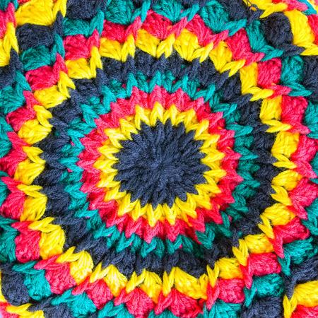 rasta hat: Ornate fabric rasta hat hippie background Stock Photo