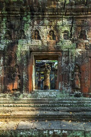 woodland sculpture: dancing Stone Carving Ruins of Angkor Wat, part of Khmer temple complex, Asia. Siem Reap, Cambodia. Ancient Khmer architecture in jungle. Stock Photo