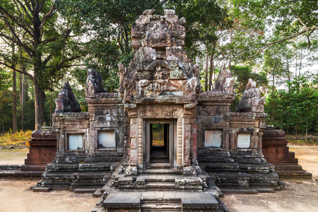 woodland sculpture: architecture of Angkor Wat, part of Khmer temple complex, Asia. Siem Reap, Cambodia. Ancient Khmer architecture in jungle. Stock Photo