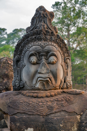 woodland sculpture: ruined face of Angkor Wat, part of Khmer temple complex, Asia. Siem Reap, Cambodia. Ancient Khmer architecture in jungle.