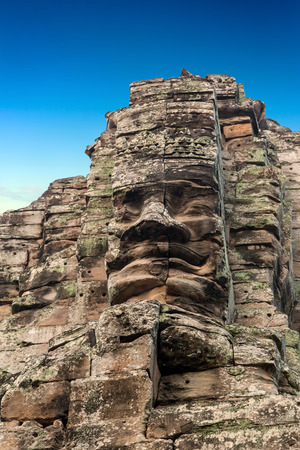 statuary: face statuary Bayon Temple Angkor Thom, Cambodia. Ancient Khmer architecture. Stock Photo