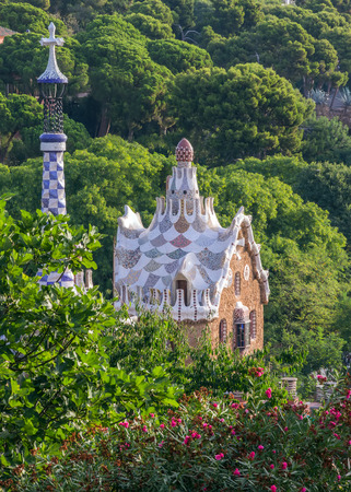 gaudi: house in garden Mosaic at the Parc Guell designed by Antoni Gaudi located on Carmel Hill, Barcelona, Spain. Stock Photo