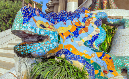 lizards: Mosaic sculpture at the Parc Guell designed by Antoni Gaudi located on Carmel Hill, Barcelona, Spain.
