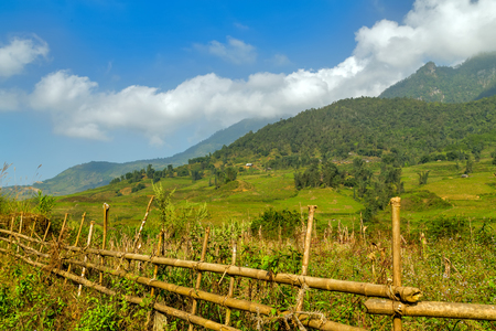 bali province: fence wooden old village of Agriculture Terraced Rice Field and hut on the hill Sa Pa. Lao Cai Province. Vietnam Stock Photo