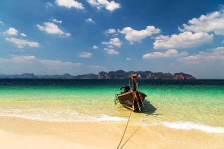 wooden boat in a tropical beach on Koh Phi Phi Island, Thailand, Asia