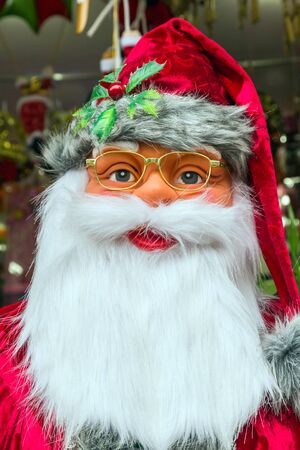 red hat: Santa Claus of european holly in red hat Stock Photo