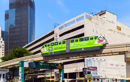 monorail: KUALA LUMPUR - FEBRUARY 21: The journey Monorail train in the city center on February 21, 2015, in Kuala Lumpur, Malaysia are KL Monorail opened on 31 August 2003, and serves 11 stations running 8.6 km.