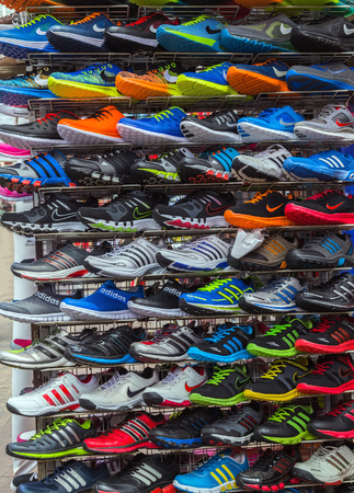 Kuala Lumpur, Malaysia - February 19, 2015: Central Market sale Adidas Shoes In Shoe Store Display and of Nike sport shoes. New unbranded running shoe, sneaker or trainer.