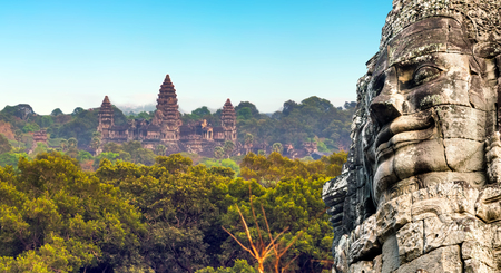 kampuchea: Ancient stone faces of king Bayon Temple Angkor Thom, Cambodia. Ancient monument Khmer architecture Kampuchea. Stock Photo