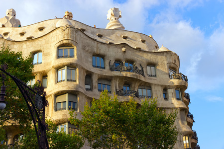 famous building: BARCELONA - AUGUST 24: Casa Mila, or La Pedrera on August 24, 2012 in Barcelona, Spain. This famous building was designed by Antoni Gaudi. Vintage retro style Editorial