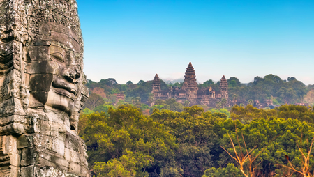 kampuchea: Ancient stone faces of king Bayon Angkor Wat, Siem Reap, Cambodia. Ancient monument Khmer architecture Kampuchea. Stock Photo