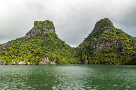 indochina: Ha Long bay islands Halong mountains in South China Sea, Vietnam. UNESCO World Heritage Site Asia. Indochina Discovery.