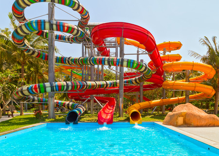Aquapark sliders, Colorful waterpark tubes and a swimming pool, water park.