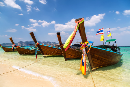 Thai boat in island bay, south of Thailand Stock Photo