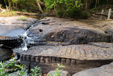 depicted: Hindu Gods and deities. Depicted in this carving is God Shiva riding on a bull with his consort Uma. Cambodia, Phnom Kulen Linga River