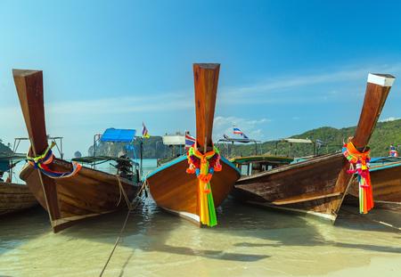 Traditional thai Boats on beach island Thailand rock