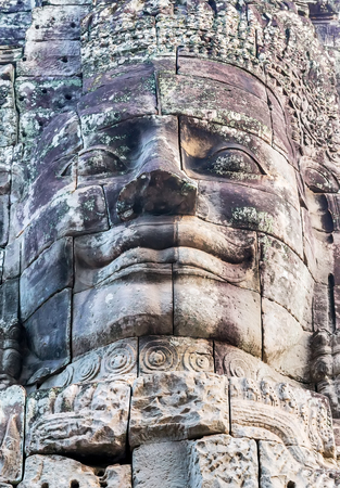 kampuchea: statue stone faces of king Bayon Temple Angkor Thom, Cambodia. Ancient monument Khmer architecture Kampuchea.