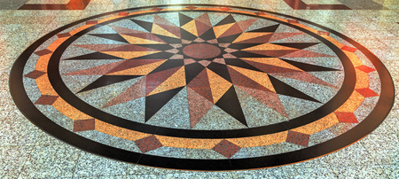 insides: Wind rose compass floor from marble colour natural stone background