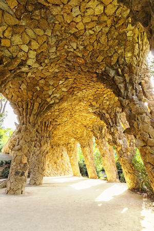 catalunia: large organic looking columns made from stone Barcelona Spain by famous architecture Anthoni Gaudi.