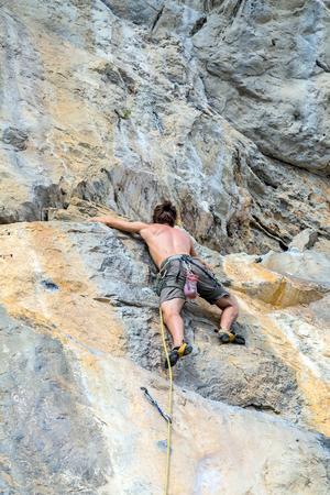 crack climbing: man Mountaineer climber rock wall extreme sport