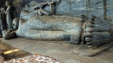 vihara: Buddha statue carved in to the rock The reclining image, which depicts the Buddhas parinirvana, is the largest in Gal Vihara, Sri Lanka, Ceylon, ancient city of Polonnaruwa, UNESCO World Heritage Site