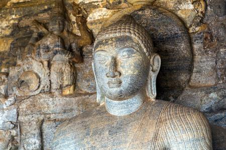 gal: Buddha statue carved in to the rock Vidyhadhara Guha in Gal Vihara, Sri Lanka Stock Photo