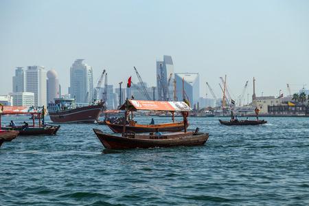 ferries: DUBAI, UAE - JANUARY 23: Boats Abra ferries on the Bay Creek in Dubaii, UAE circa January 2016 Editorial