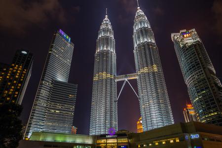 twin tower: KUALA LUMPUR - FEBRUARY 19, 2015: Petronas Twin Towers in Kuala Lumpur was illuminated with neon unlike the ordinary white color neon. Petronas Towers in night scene at Kuala Lumpur, Malaysia