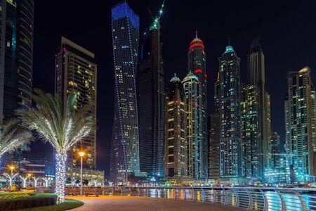 illuminated: Panorama of illuminated Dubai marina, Dubai pier, architecture UAE