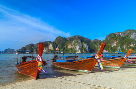 Traditional thai Boats on beach island Thailand travel