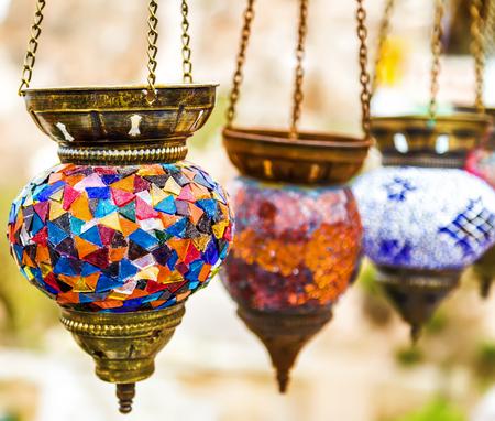 Hanging colorful arabic lamps illuminated islamic Stock Photo