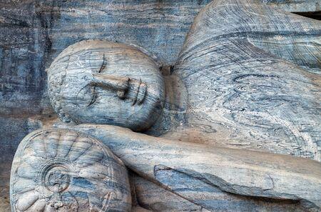 gautama buddha: Gautama Reclining Buddha nirvana statue entering Parinibbana at the Gal Vihara in Polonnaruwa. , Sri Lanka.