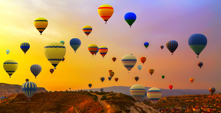 air: Hot air balloons landing in a mountain Cappadocia Goreme National Park Turkey.