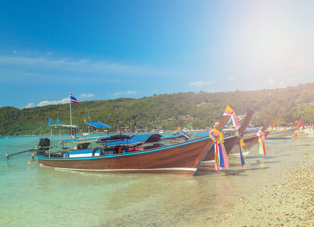 Traditional thai Boats on beach island Thailand, vintage nature background