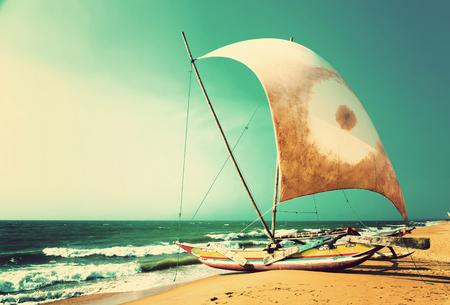 sailboat on the sea coast, nautical Sri Lanka, vintage nature background