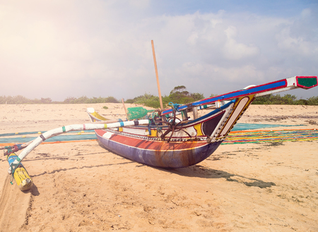 fishing boat and fishing net on the ocean coast of Sri Lanka, vintage nature background