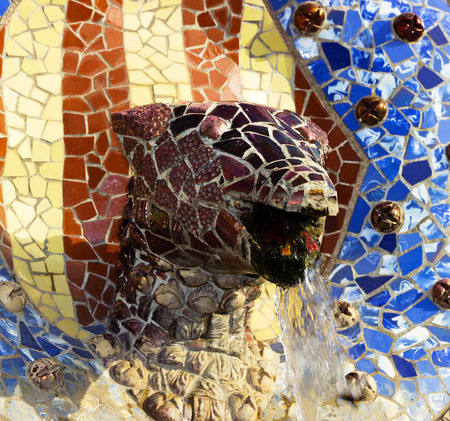 trencadis: fountain mosaic tiles sculpture of a snake in Barcelona Editorial