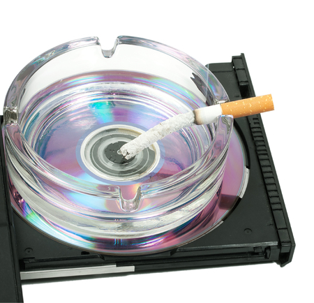ashtray of cigarette butts filter on cd-rom isolated on a white background Stock Photo