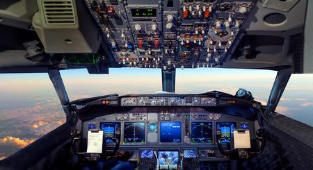 cockpit Airplane flying above tropical sunset 版權商用圖片