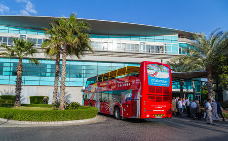 DUBAI, UAE - JANUARY 26, 2016: Touristic Big Bus excursion City Sightseeing Dubai, The Day Tour is a hop-on, hop-off tour of Dubai, with a personal recorded commentary available. Editorial