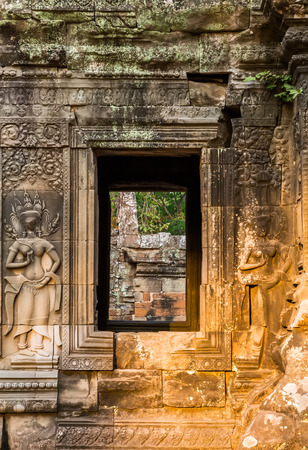 Ruins of Angkor Wat, part of Khmer temple complex, Asia. Siem Reap, Cambodia. Ancient Khmer architecture in jungle.