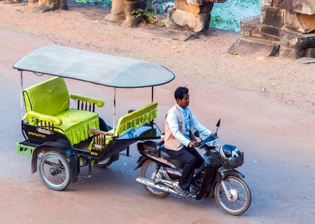 Siem Reap, Cambodia - 01 MARCH, 2015: Asian rickshaw Taxi in Cambodia Tuk Tuk of Angkor Wat, Khmer temple complex, Asia.