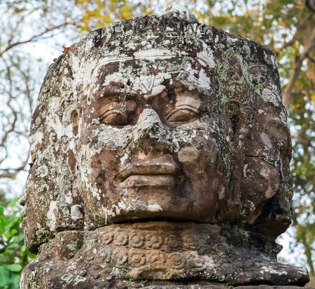 Head stone, Ruins of Angkor Wat, part of Khmer temple complex, Asia. Siem Reap, Cambodia. Ancient Khmer architecture in jungle. Stock Photo