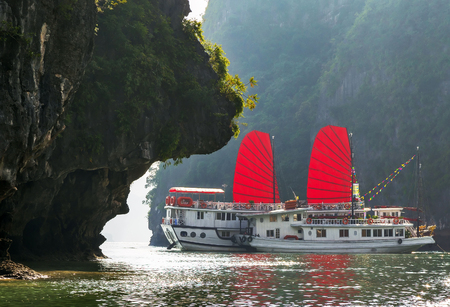 Ha Long Bay Vietnam traditional boat red sail. Unesco World Most popular place. Stok Fotoğraf