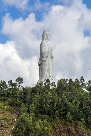Lady Buddha (the Bodhisattva of Mercy) at the Linh Ung Pagoda, Danang (Da Nang), Vietnam. White Buddha statue on blue sky background. Stock Photo