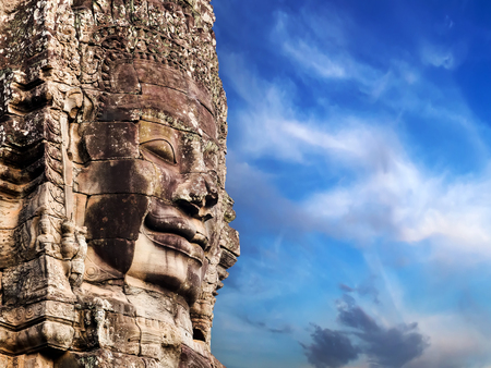 Buddhist Stone face in Bayon Temple Angkor Thom, Cambodia. Ancient monument Khmer architecture.