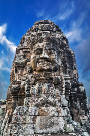 cambodge: Buddhist Stone face Khmer Smile in Bayon Temple Angkor Thom, Cambodia. Ancient monument Khmer architecture.